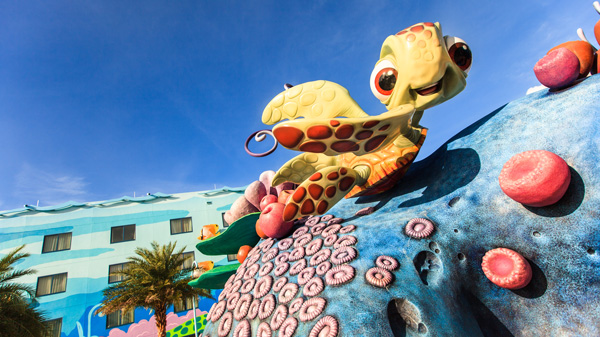 Squirt the baby sea turtle smiles and strikes a pose outside of Disney's Art of Animation Resort