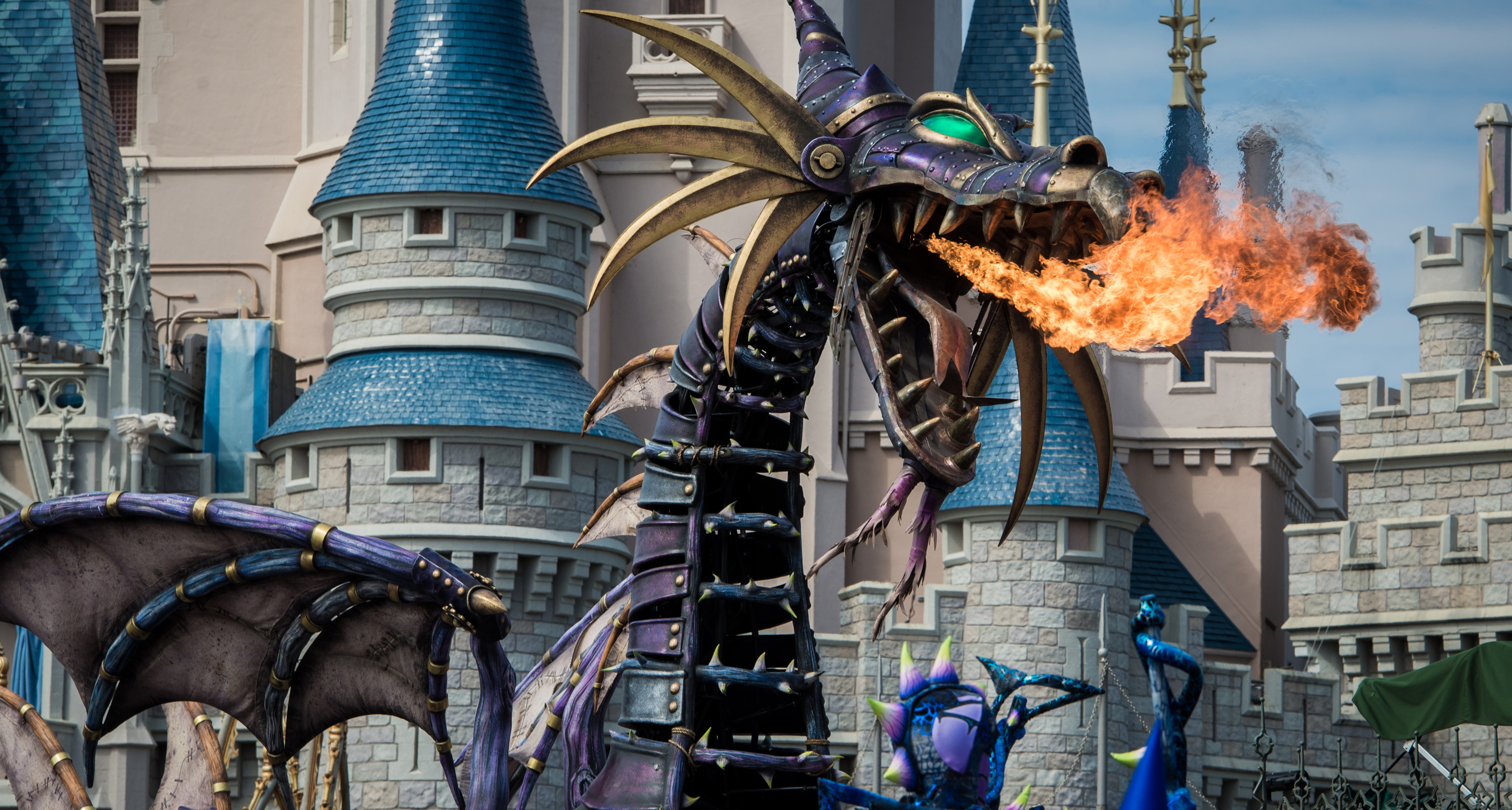 Dragon Maleficent breathing fire during the Disney Festival of Fantasy Parade at Magic Kingdom park