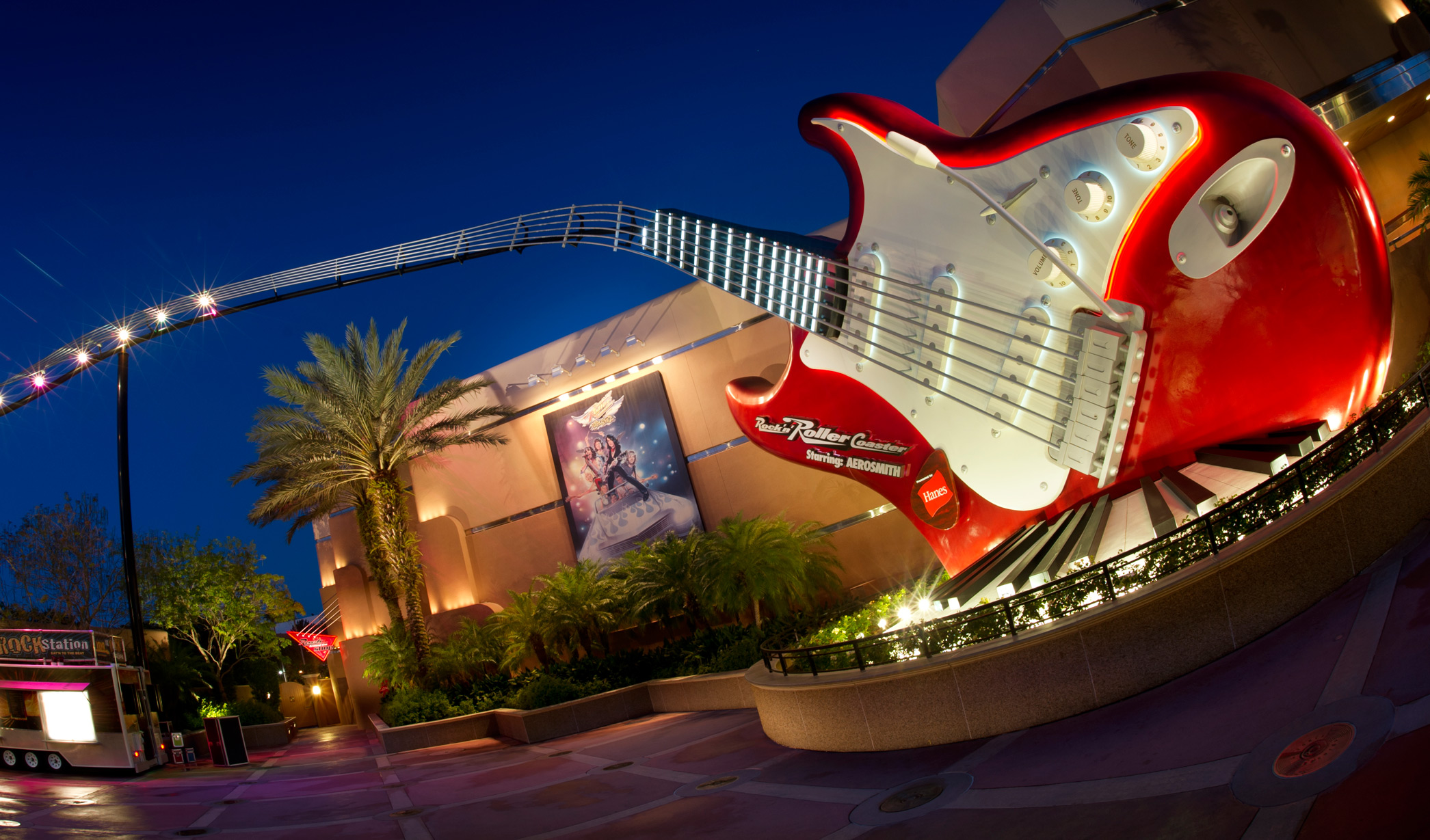 The neck of a giant guitar transforming into a track at Rock 'n' Roller Coaster Starring Aerosmith