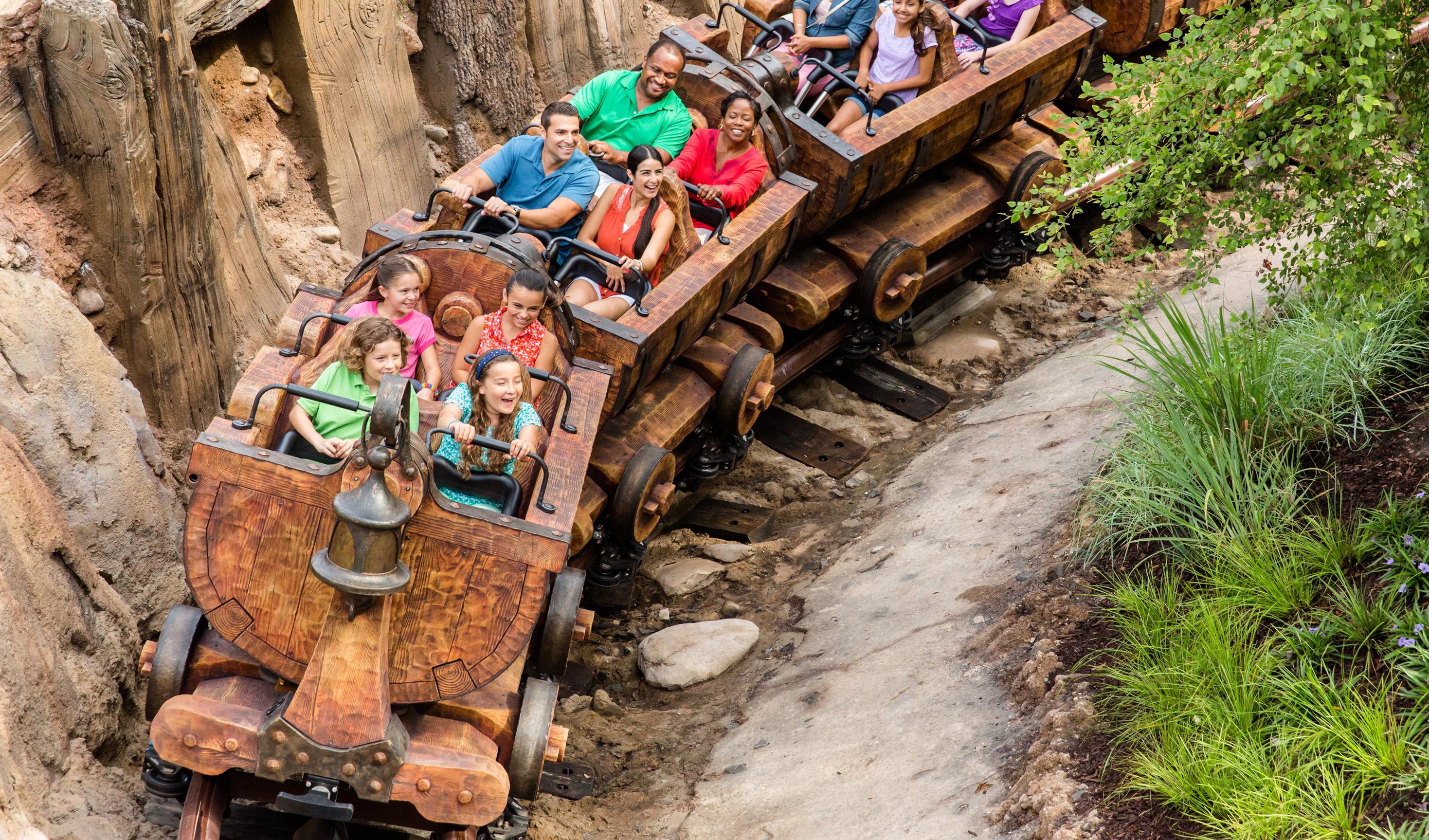 Multiple Guests enjoying a rollicking ride aboard the Seven Dwarfs Mine Train at Magic Kingdom park
