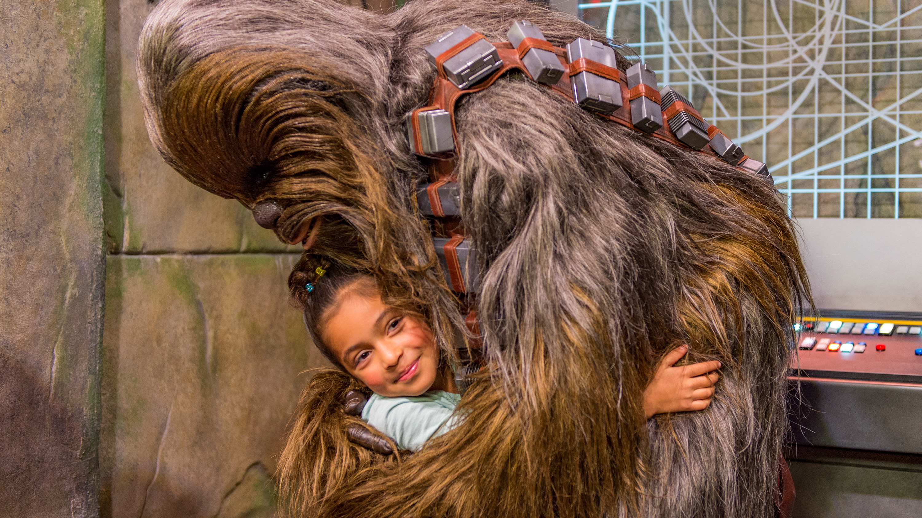 Chewbacca gives a warm hug to a young girl at a Star Wars meet-and-greet at Walt Disney World Resort