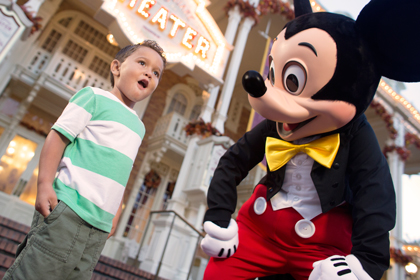 Preschool boy Meets Mickey Mouse in front of the Town Square Theater