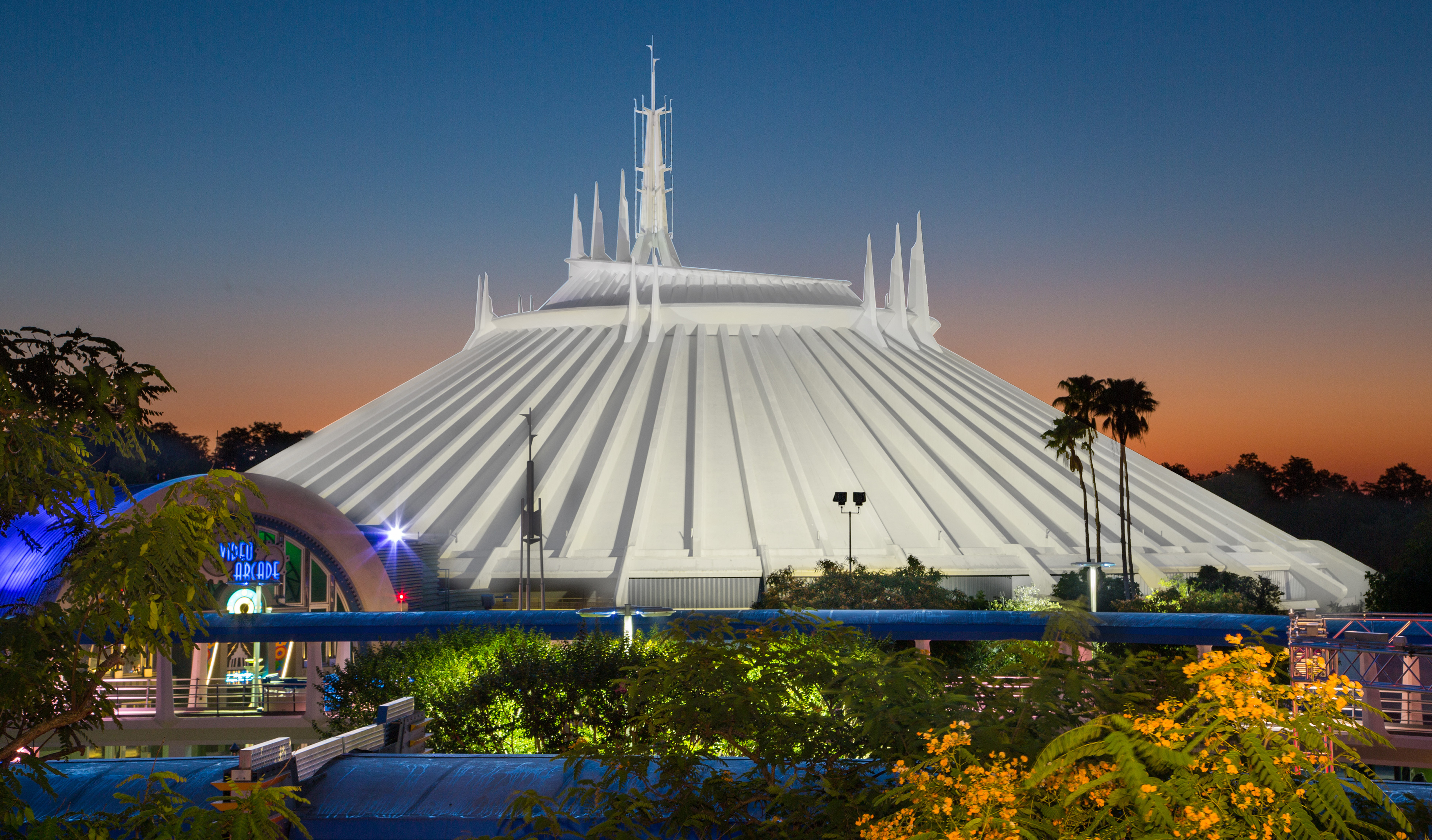 Spires on the roof of Space Mountain rising into the night sky in Tomorrowland at Magic Kingdom park
