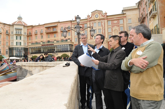 Tom Staggs visits Mediterranean Harbor during a Tokyo DisneySea park tour.  In the photo (from left to right) are Dave Vermeulen, VP & Executive Managing Director, Walt Disney Attractions Japan, Tom Staggs, Daniel Jue, Director, Design and Production, Tokyo Disney Resort, Walt Disney Imagineering Japan, Jim Hunt, EVP/CFO, Walt Disney Parks & Resorts, Bill Earnest, President and Managing Director, Asia, Walt Disney Parks & Resorts and Craig Russell, Chief Design & Project Delivery Executive, Walt Disney Imagineering.
