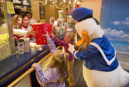 Disney VoluntEARS Serving Movie Snacks and Popcorn'