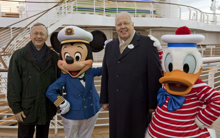 Captain Mickey and Donald Duck with Managing Partner of Meyer Werft, Bernard Meyer, and President of Disney Cruise Line, Karl Holz