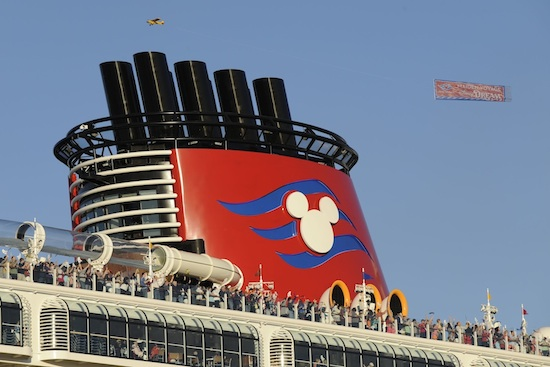 A Plane Tows a Banner Overhead Saluting the Ship's Maiden Voyage