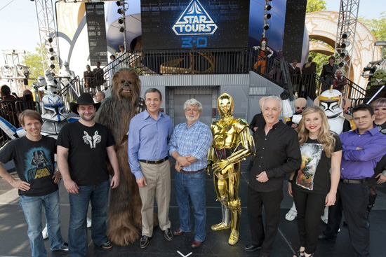 Bob Iger, George Lucas, and several 'Star Wars' characters and cast members celebrate the attraction's opening.