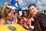 (MAY 30, 2011): Newly crowned 'American Idol' Scotty McCreery (right) signs an autograph May 30, 2011, for fan Sarah Solley (left), age 15, from Orlando, Fla., at Disney's Hollywood Studios in Lake Buena Vista, Fla. McCreery was honored in a parade at the Disney theme park and performed his new single 'I Love You This Big.' On Wednesday, the 17-year-old singer was crowned the new 'American Idol' on the season finale which was viewed by an estimated 29.3 million people. (Matt Stroshane, photographer)
