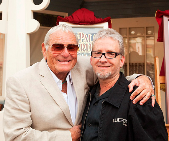Rolly Crump (left) and Chris Crump (right) at the 2009 dedication of a Main Street, U.S.A., window in Rolly's honor.