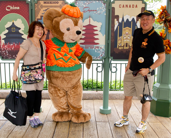 Mr. and Mrs. Noriake Sakata with Duffy the Disney Bear in his Halloween Costume at Epcot