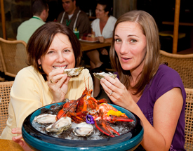 Erin and Pam savor the briny New Zealand oysters from Off the Hook's 'Feast of the Sea' platter.