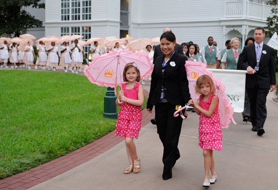 Eva Brackmann and Rachel Pinne Lead the Parasol Parade at Disney's Grand Floridian Resort & Spa
