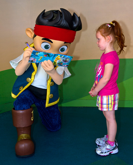 Morgan Calhoun from Round Lake Beach, Ill., Awaits an Autograph from Jake of 'Jake and the Never Land Pirates' at Disney's Hollywood Studios