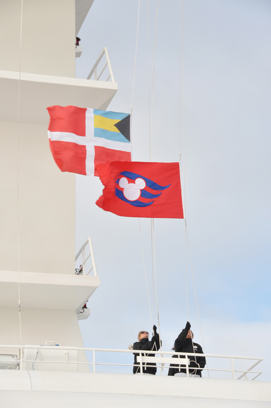 Lowering the Meyer Werft Flag and Watching the Disney Cruise Line Flag Rise, Transferring Ownership from the Shipbuilder to Disney
