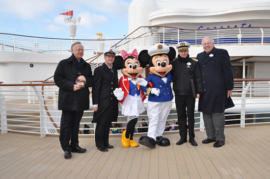 Mickey and Minnie Mouse with (from left to right) Bernard Meyer, managing partner of Meyer Werft, Captain Wolfgang Thos, also from Meyer Werft, Captain Tom Forberg, and Karl Holz, president of Disney Cruise Line