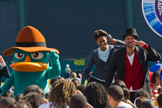 First Lady Michelle Obama joins Perry The Platypus and choreographer Rosero McCoy in performing 'The Platypus Walk,' made famous in Disney Channel's series 'Phineas and Ferb.' Mrs. Obama was at Walt Disney World Resort to celebrate the second anniversary of her Let's Move! initiative and the Disney Magic of Healthy Living, both of which promote healthier lifestyles among children and families.