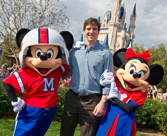 Super Bowl MVP from the New York Giants Eli Manning with Mickey and Minnie Mouse at Walt Disney World Resort