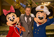 Alan Cumming with Mickey and Minnie Mouse on the Disney Fantasy