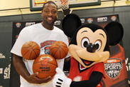 On the heels of recruiting Lebron James and Chris Bosh to join him in South Florida, Miami Heat star Dwyane Wade visits the complex, and plays in a special 3-on-3 basketball game with AAU girls' basketball players and Mickey Mouse.