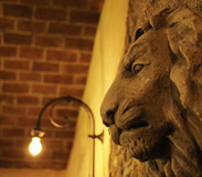 Detail of Stone Lion Head on Wall in Tutto Gusto in the Italy Pavilion at Epcot