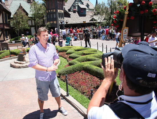 Richard Wilkins, Entertainment Editor of Australia's 'Today' Show on the Nine Network, in Front of King Arthur Carrousel at Disneyland Park