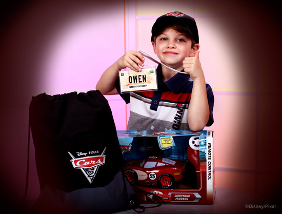 Owen with the 'Cars 2' Super Fan Kit from Disney Floral & Gifts
