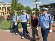 World War II Veteran and Purple Heart Recipient Louis Lessure Participates in the Flag Retreat Ceremony at Magic Kingdom Park