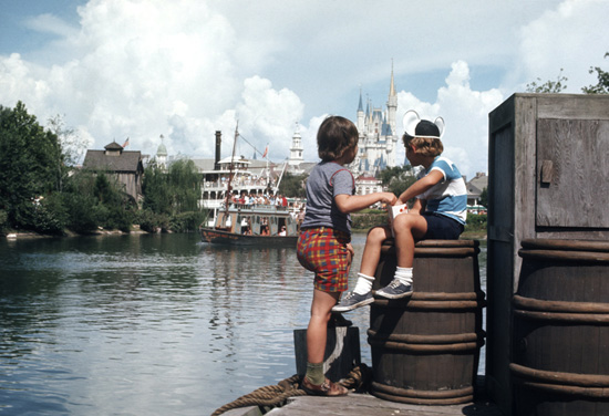 In This 1974 Photo from Magic Kingdom Park, Two Guests Look Out Over the Rivers of America