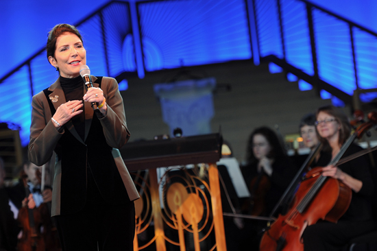 Meg Crofton, President of Walt Disney Parks and Resorts Operations, United States and France, Presented $100,000 Donation to Central Florida Organizations During the Candlelight Processional at Epcot