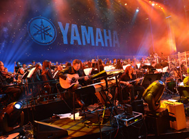 A 60-piece orchestra led by Nathan East and James Newton Howard performs during Yamaha's 125th Anniversary Concert