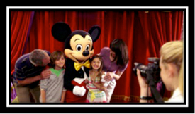 One of the Disneyland Paris PhotoPass Photographers capturing an amazing Meet & Greet moment with Mickey that will be cherished for a lifetime!