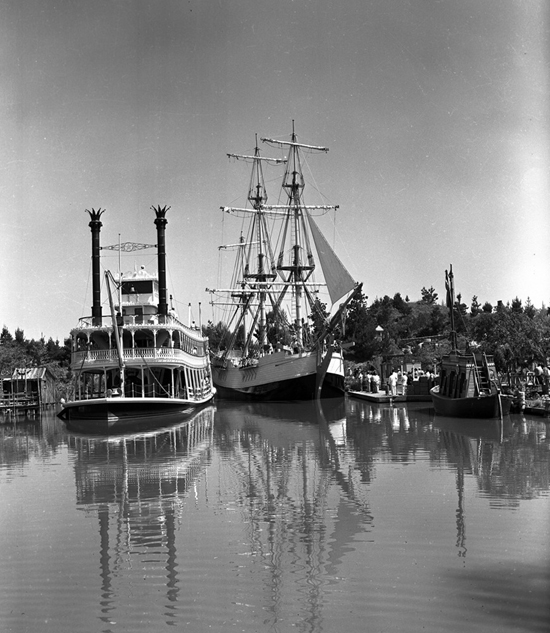 Sailing Ship Columbia Alongside the Mark Twain Riverboat at Disneyland Park in 1958