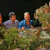 James Cameron, Walt Disney Parks & Resorts Chairman Tom Staggs and Imagineer Joe Rohde View a Model of the AVATAR-Themed Land Coming to Disney's Animal Kingdom at Walt Disney World Resort
