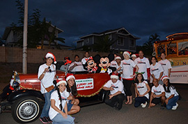 Mickey, Minnie and Disney VoluntEARS at the Kapolei Holiday Lights Parade