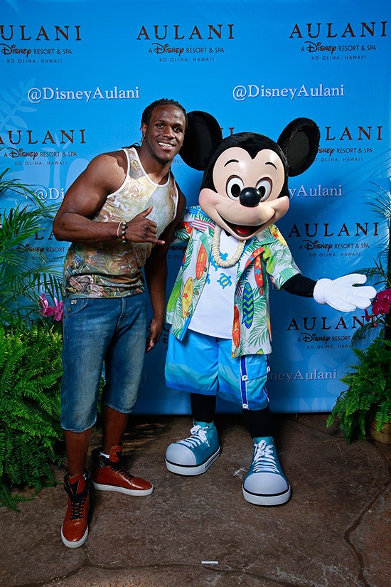 NFL Pro Bowl Running Back Jamaal Charles of the Kansas City Chiefs with Mickey Mouse at Aulani, a Disney Resort & Spa