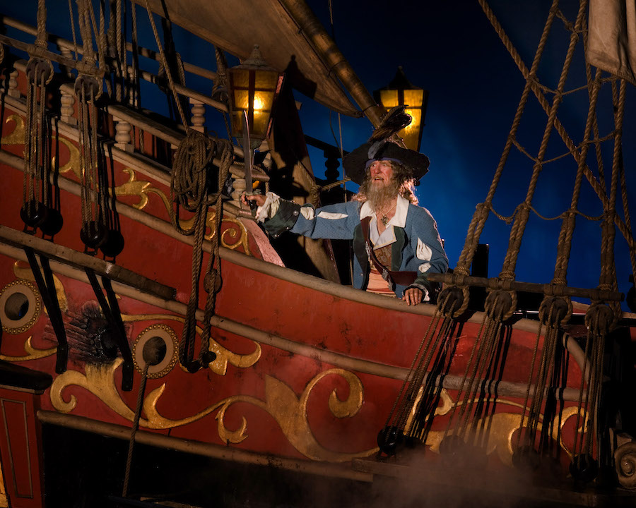 GIVE UP JACK SPARROW --  With Barbossa now at them helm of the Wicked Wench, the epic battle scene of the Pirates of the Caribbean attraction takes on added drama as the villainous pirate bombards the town where Captain Jack Sparrow is hiding. The classic attraction re-opens at Disneyland in California on June 26 and in Florida's Magic Kingdom on July 7 following an extensive three-month enhancement and featuring new characters and elements from Disney's Pirates of the Caribbean films.