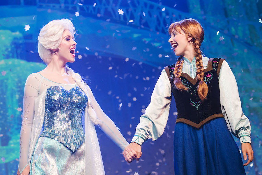 """Royal sistersQueen Elsa andPrincess Anna, from the Disney hit animated motion picture """"Frozen,"""" join the Royal Historians of Arendelle fora hilarious and interactive retelling of the """"Frozen"""" storyin""""For the First Time in Forever – a 'Frozen' Sing-Along Celebration"""" at Disney's Hollywood Studios guests. The 30-minute show ispresented multipletimes daily inside Premiere Theater, inviting guests to sing along to the chart-topping soundtrack. Disney's Hollywood Studios is one of four theme parks at Walt Disney World Resort in Lake Buena Vista, Fla.(Chloe Rice, photographer)"""