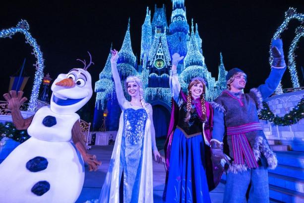 "Queen Elsa from ""Frozen"" Transforms Cinderella Castle in ""A Frozen Holiday Wish"""