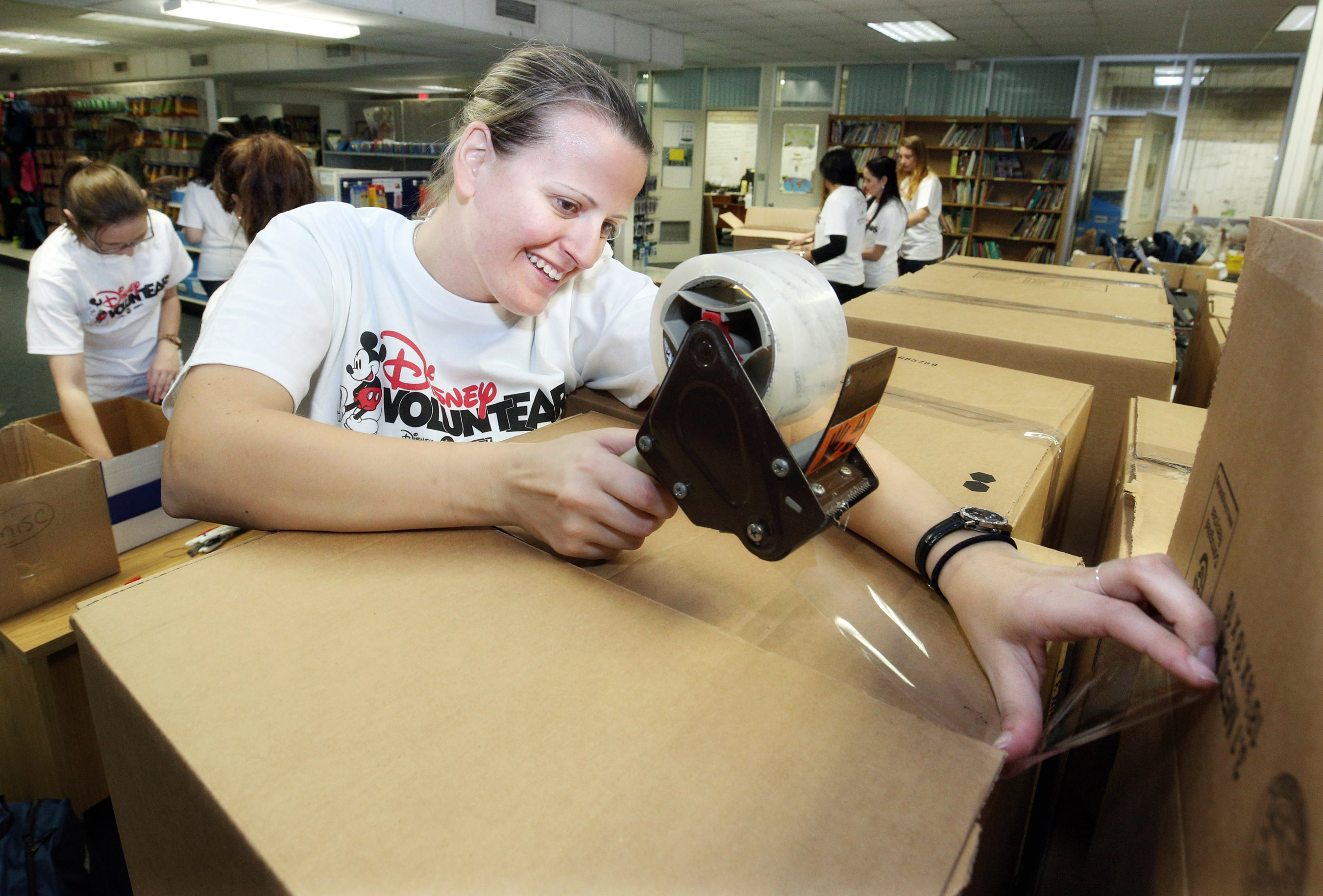 Disney Cruise Line Crew Members Volunteer at Brevard County Supply Zone for Teachers 2