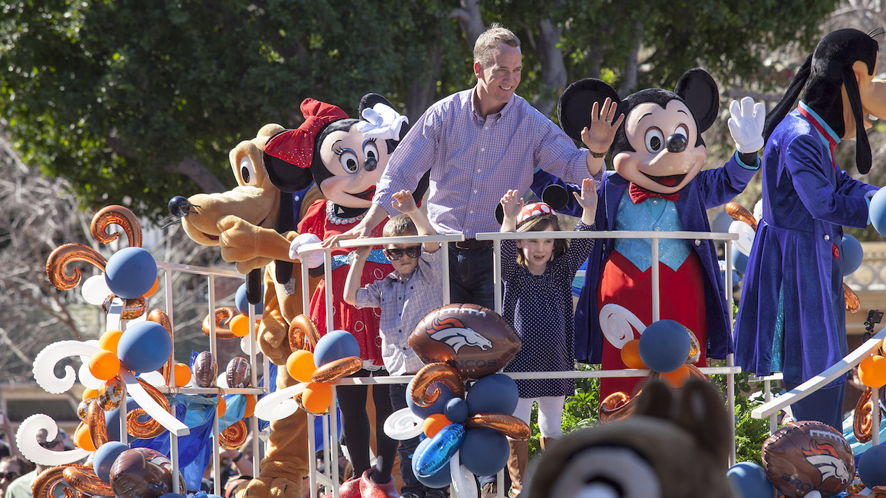 (February 8, 2016) In honor of the Denver Broncos' unforgettable victory at Super Bowl 50, the Disneyland Resort saluted quarterback Peyton Manning with a champion's parade down Main Street, U.S.A. at Disneyland Park in Anaheim, Calif., on Monday. Some favorite Disney characters joined the parade as Manning rode in a float with his children, Mosely and Marshall. (Scott Brinegar/Disneyland Resort)