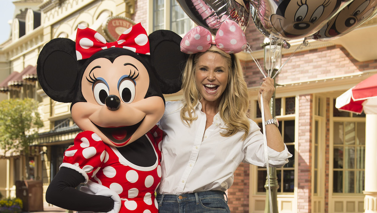 (March 15, 2016): Supermodel and actress Christie Brinkley dons polka dots for a photo with Minnie Mouse March 15, 2016 while vacationing at Magic Kingdom park in Lake Buena Vista, Fla. Magic Kingdom is one of four theme parks at Walt Disney World Resort. (David Roark, photographer)