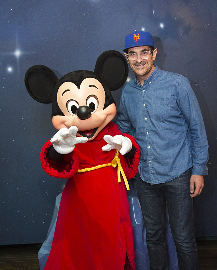 Actor Ty Burrell meets with Mickey Mouse during a visit to Disneyland Park