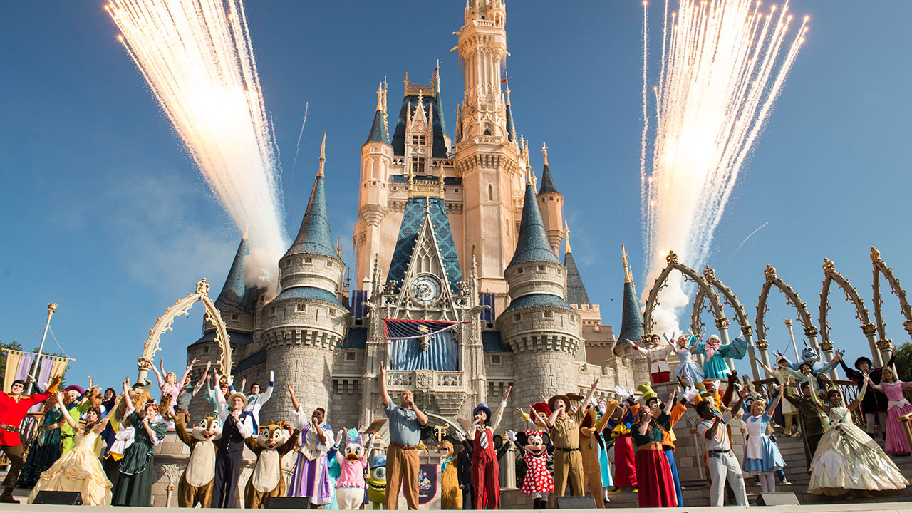 Walt disney world president george a kalogridis surrounded by a flurry of beloved disney