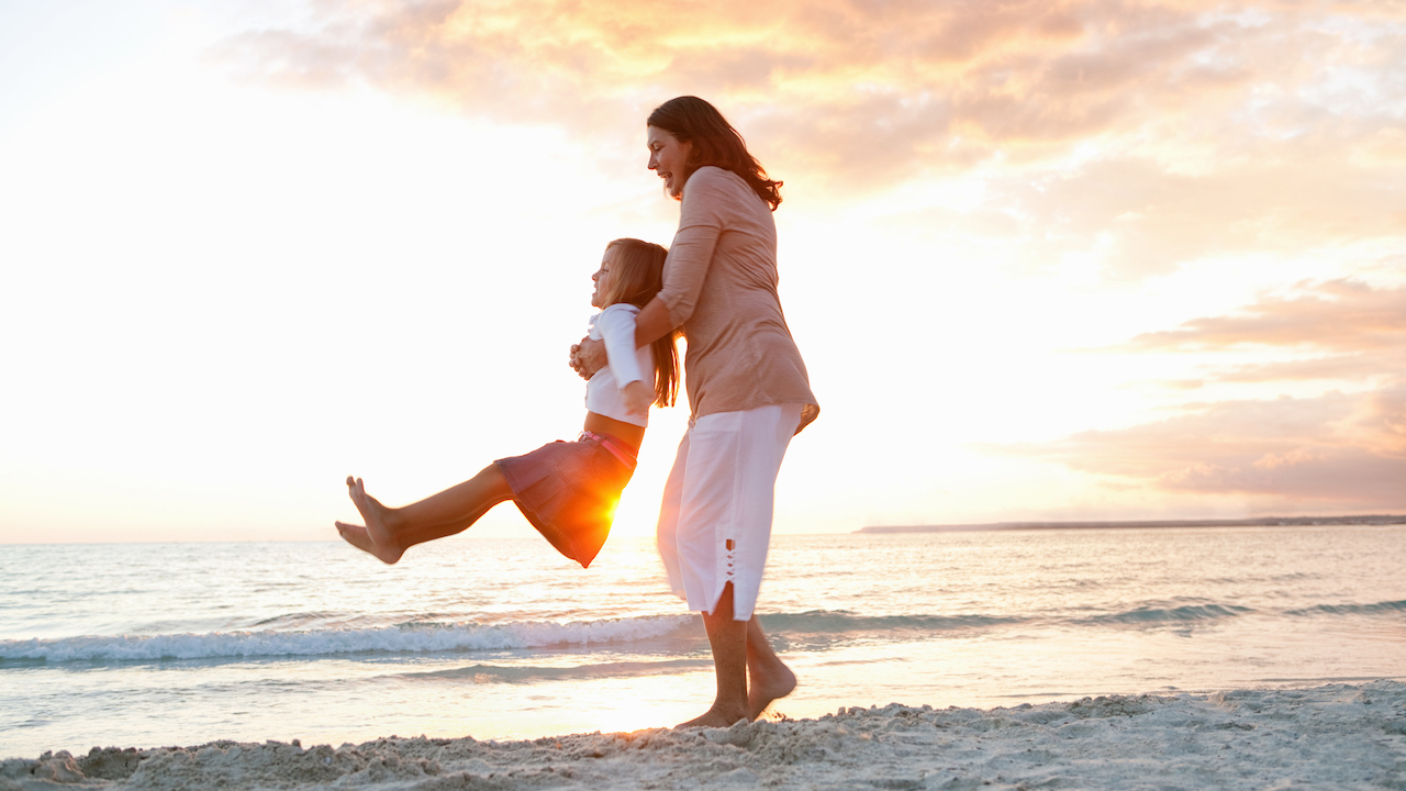 Family on the beach during sunset on Adventures by Disney Costa Rica Vacation Package