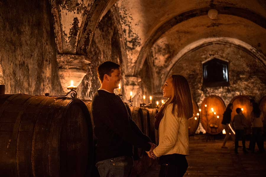 Couple visiting a winery in Europe.