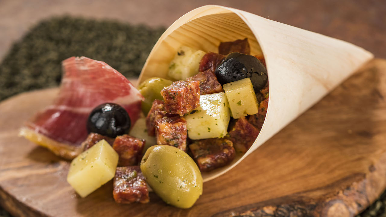 Charcuterie in a Cone with a selection of imported Spanish Meats, Cheeses, and Olives with an Herb Vinaigrette