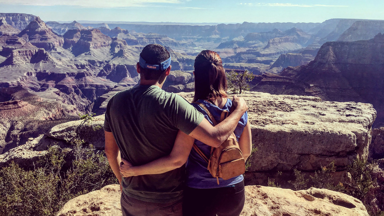A couple viewing the Grand Canyon