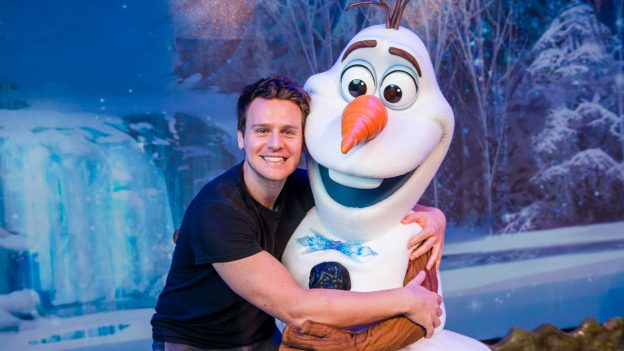 Jonathan Groff poses with Olaf