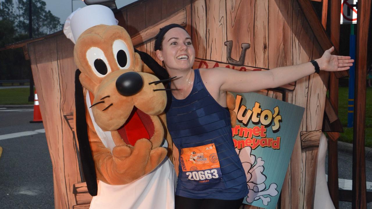 Hayley Brown with Pluto during Disney Wine & Dine Half Marathon Weekend